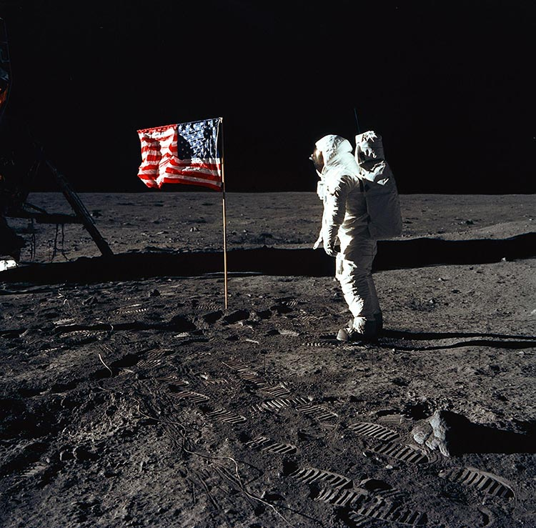Astronaut Edwin E. Aldrin Jr., lunar module pilot of the first lunar landing mission, poses for a photograph beside the deployed United States flag during an Apollo 11 extravehicular activity (EVA) on the lunar surface. Photo: NASA